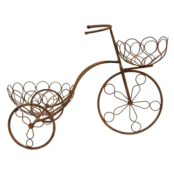 Brown tricycle. Bicycle metal plant stand