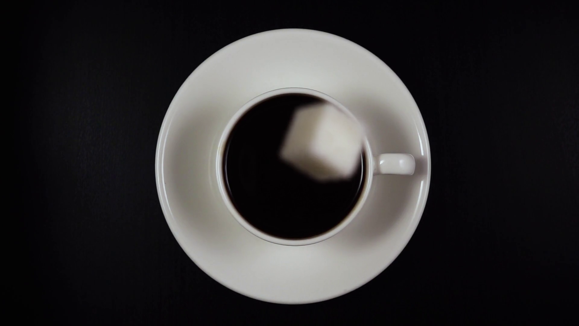 Coffee cup png top down. Sugar cube falls into