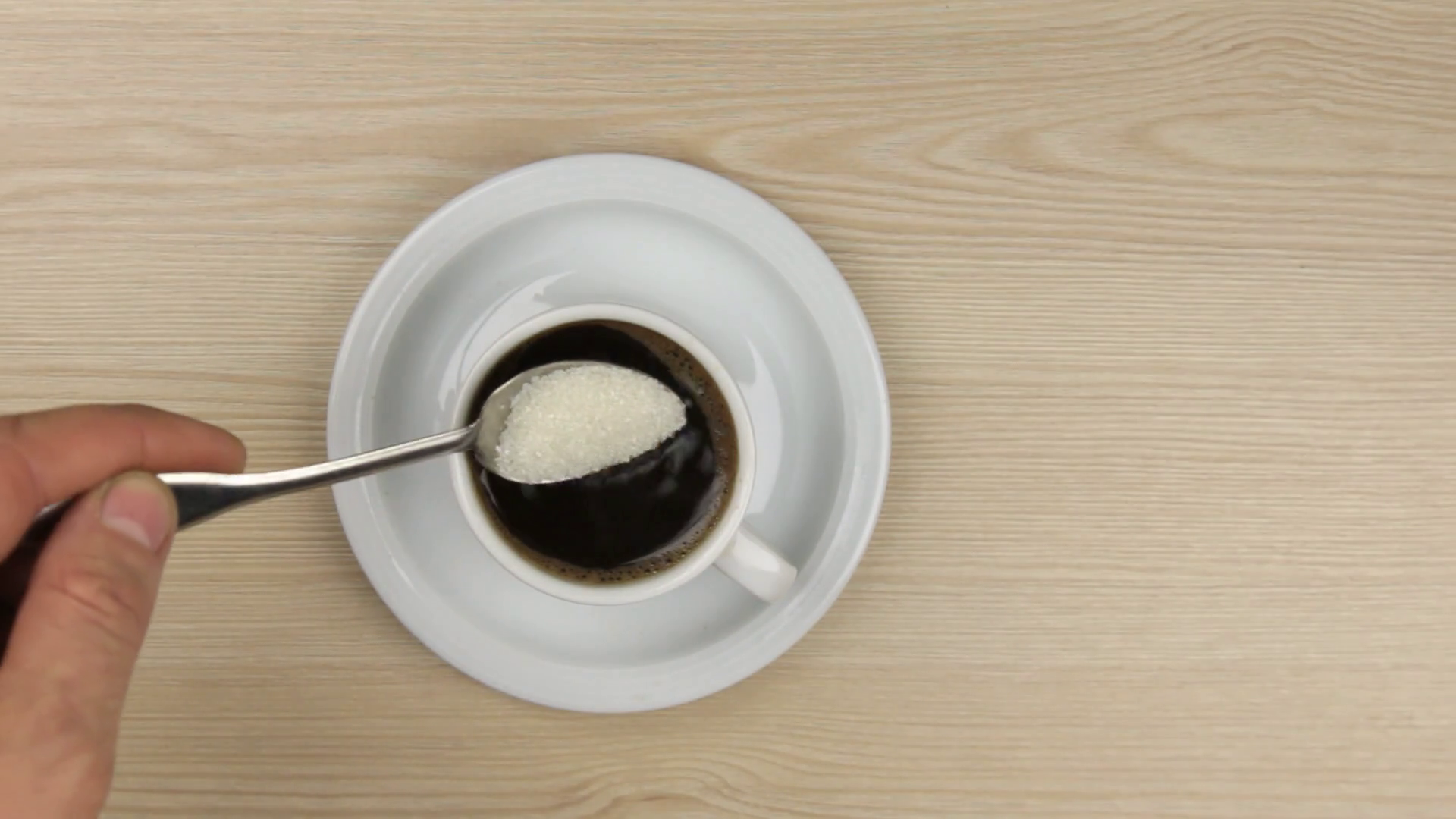 Coffee cup png top down. Hand putting spoon sugar