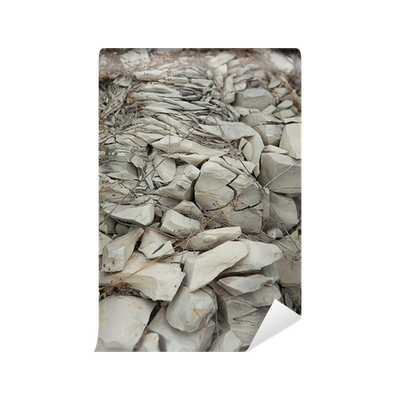 Cracked drawing rock. Rocky gray background wall