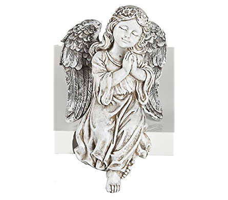 Drawing statue angel. Sitting with praying hands