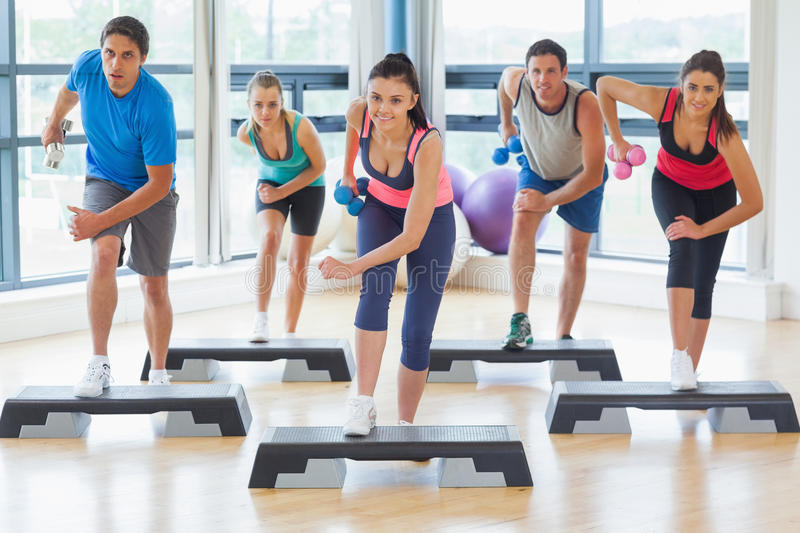 Instructor with performing step. Dumbbell clipart fitness class picture freeuse download