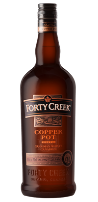 Whiskey drawing beer bottle. Forty creek whisky copper