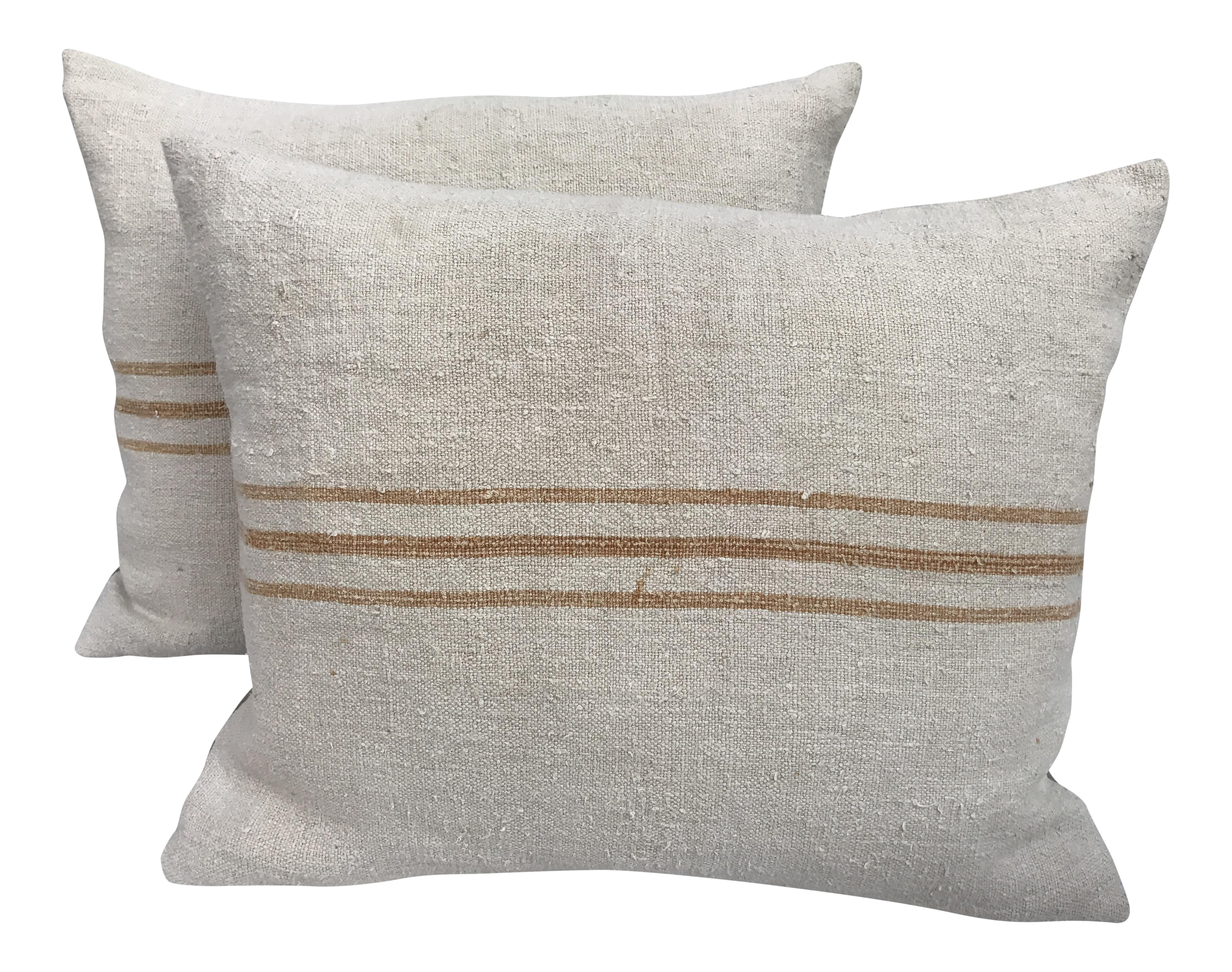 Grain sack png. Golden striped english pillows