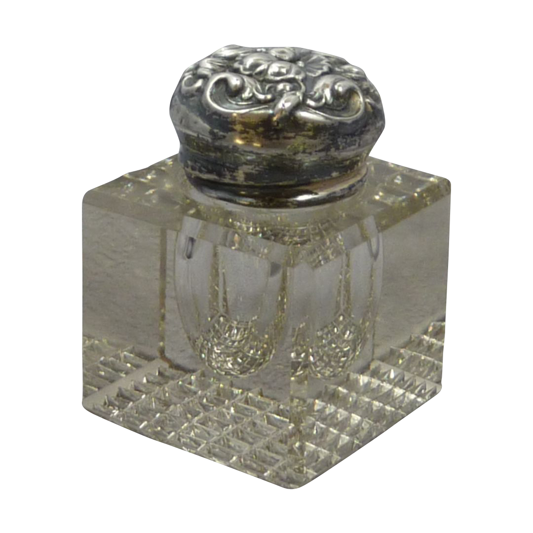 Jar transparent decorative glass. Ink with repousse silver