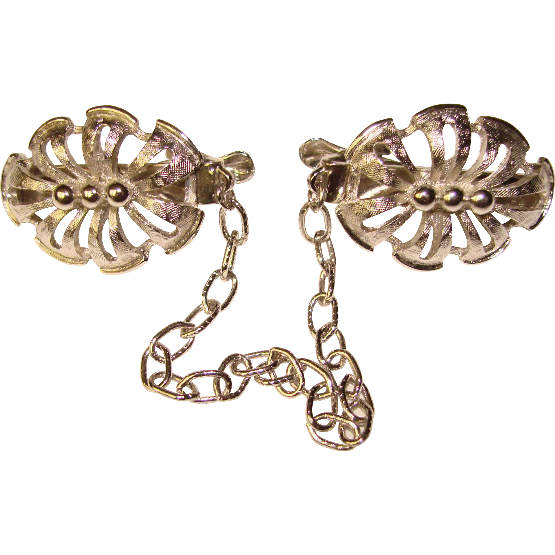 Jewelry clip sweater. Awesome ornate silver finish