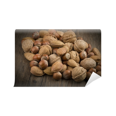 Nuts transparent wall. Mix close up on