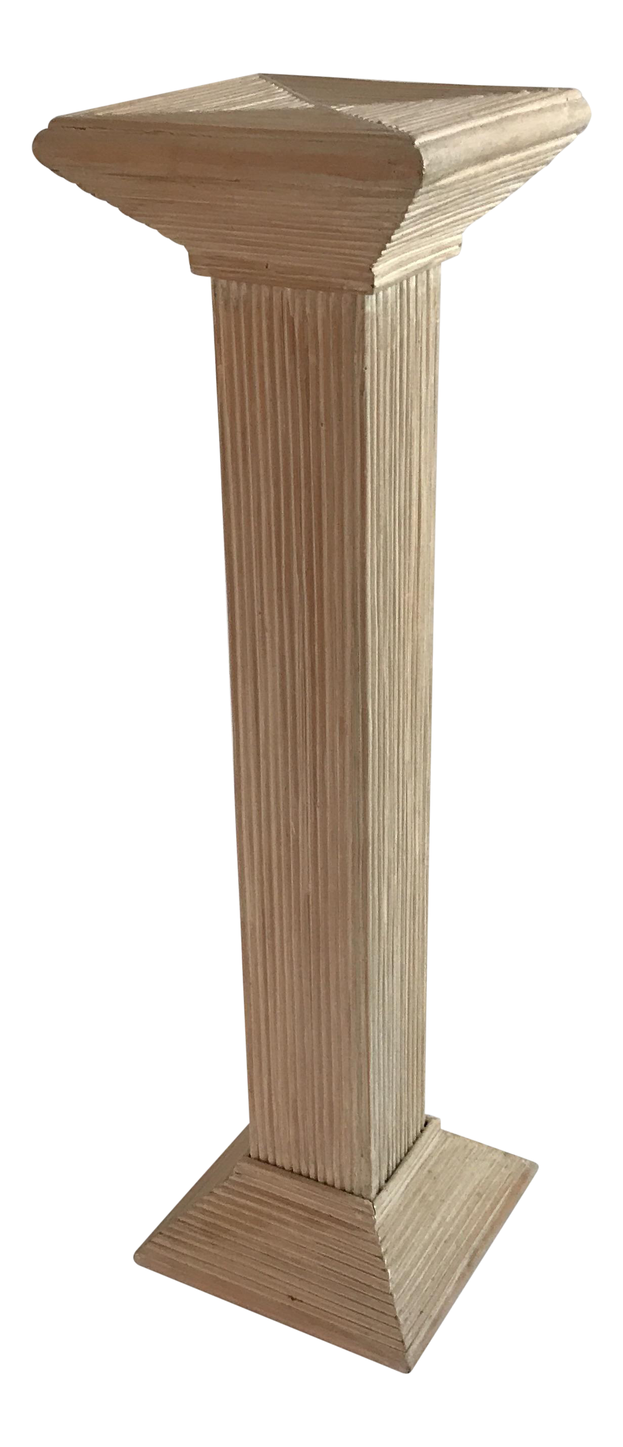 Pedestal drawing ionic. Reeded washed rattan chairish