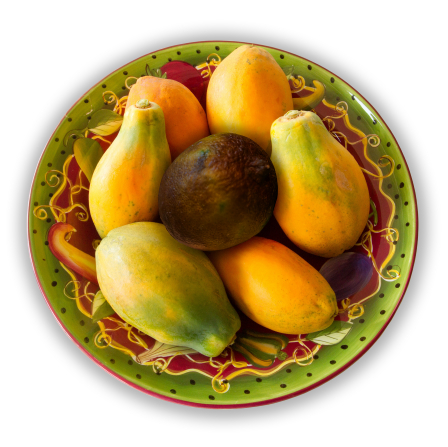 Rotten papaya. Bowl of fruit