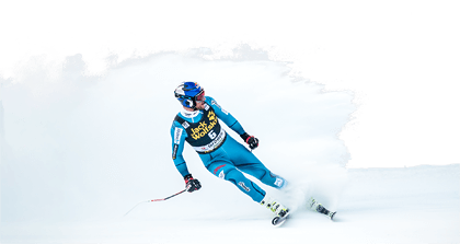 Skier drawing down hill. Fis ski world cup