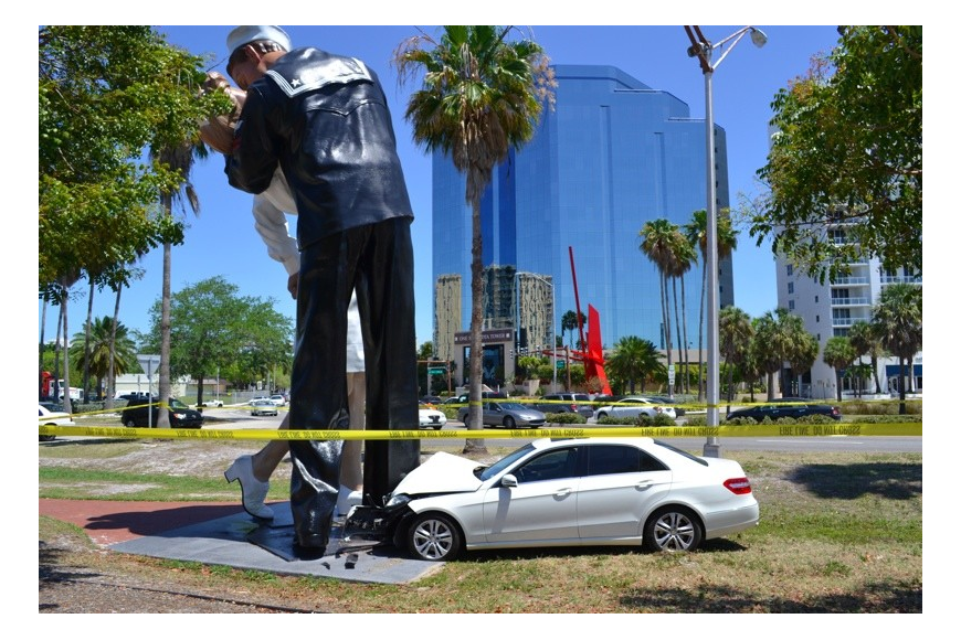 Unconditional surrender statue png. Car crashes into sarasota