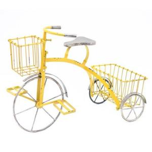 Yellow tricycle. Antique metal plant stand